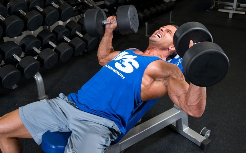 Muscle & Strength Athlete Doing Chest Presses in the Gym
